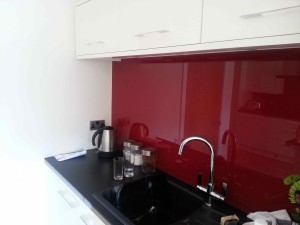 jem-cream-kitchen-with-red-glass-back-web